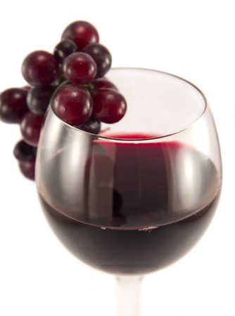close up image: Glass of red wine with grape close up image Stock Photo