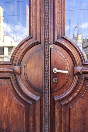 manacle: Massive oak door with the reflection on the glass Stock Photo