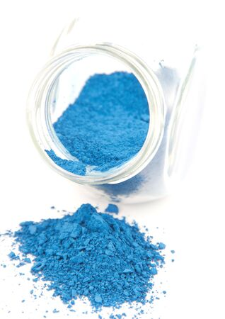 Blue pigment in a glass jar on a white background Stock Photo