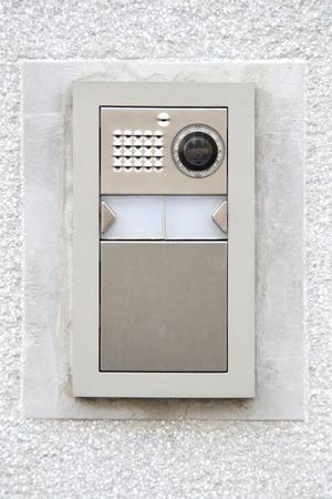 Intercom su una facciata di marmo Archivio Fotografico