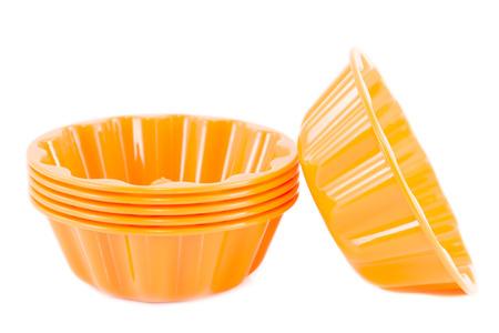 Orange pudding molds isolated