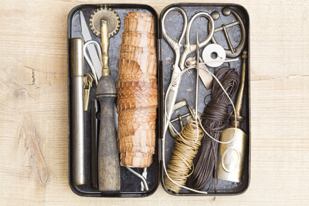 Leather craft tools in the vintage metal box photo