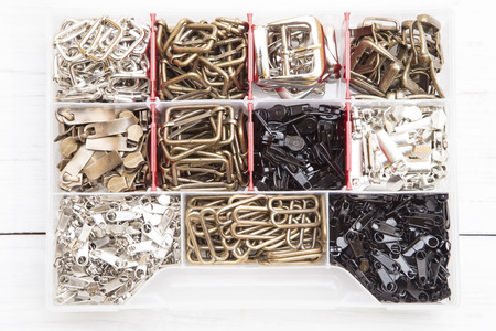 sewing box: Metal sewing elements in a plastic box Stock Photo