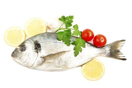 aurata: Aurata fish with the fresh vegetables Stock Photo