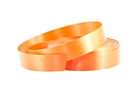 Roll of the orange ribbon isolated on white