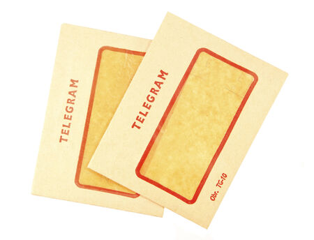 telegram: Two old telegram envelopes on white