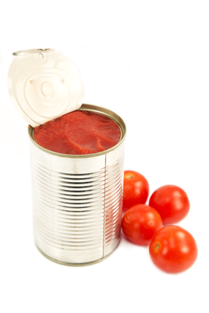 Open can of tomato sauce with the cherry tomatoes isolated Standard-Bild