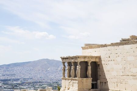 caryatids: Erechtheion temple with  Porch of the Caryatids with the view on Athens