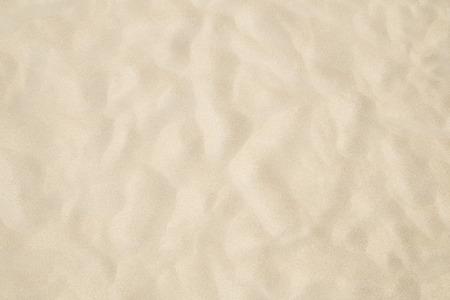 Strand zand als achtergrond Stockfoto