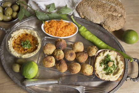 silver tray: Hummus and falafel on a silver tray Stock Photo
