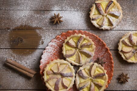apple tart: Apple tart and spices on a wooden background