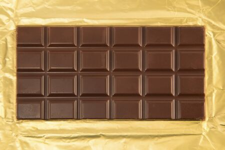 unwrapped: Unwrapped chocolate bar Stock Photo