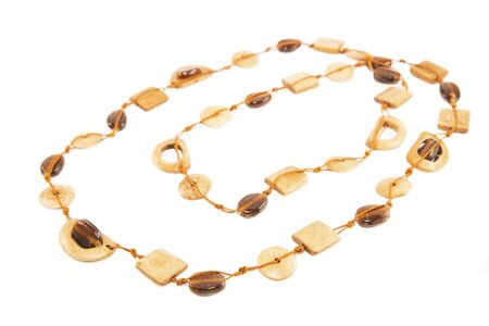 ivory: Amber and ivory necklace isolated