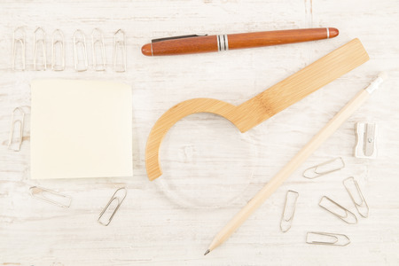 graver: Stationery equipments on a white wooden background Stock Photo