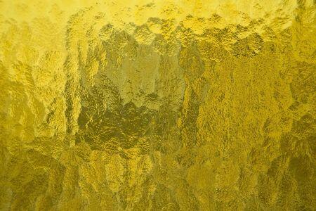 Yellow glass texture close up photo