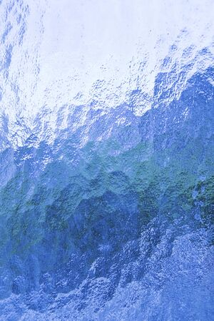Blue glass texture close up photo