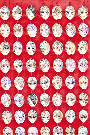 festal: Small Venetian masks on a red background
