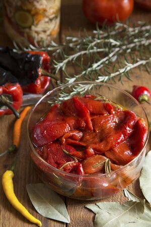 briny: Pickled vegetables and spices on a wooden background
