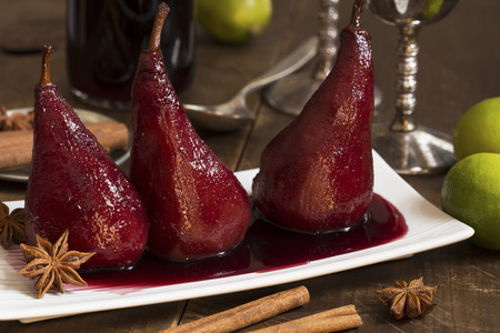 Pears boiled in red wine with spices