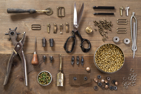 wood craft: Leather craft tools on a wooden background