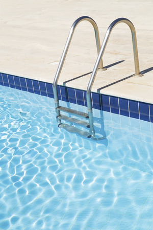 Swimming pool with stairs Standard-Bild