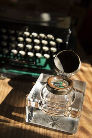 ink well: Antique crystal inkwell and a typewriter
