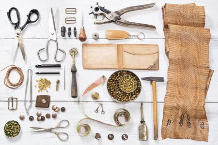 leather background: Leather craft tools and the snake skin