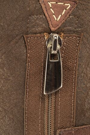 Zipper on a leather boot close up photo