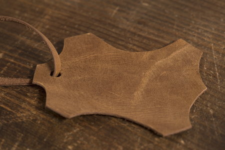 leather label: Leather label on a wooden
