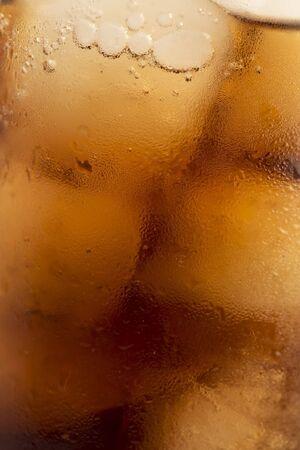 Macro image of  cola with ice photo