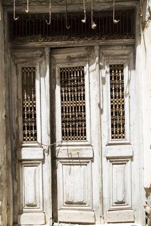 manacle: Old grunge wooden door