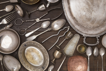 silver tray: Vintage silver utensils on a wooden background