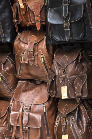 pack string: Leather back packs on a market