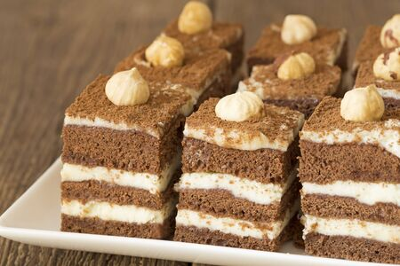 chocolate cakes: Chocolate cakes with hazelnuts on a plate