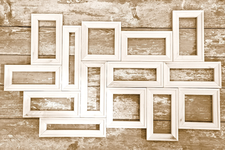 toned image: Composition of the small plain wooden frames - toned image