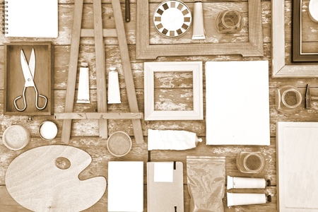 toned image: Painting equipment on a wooden background - toned image Stock Photo
