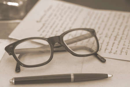 toned image: Vintage glasses and pen - toned image Stock Photo