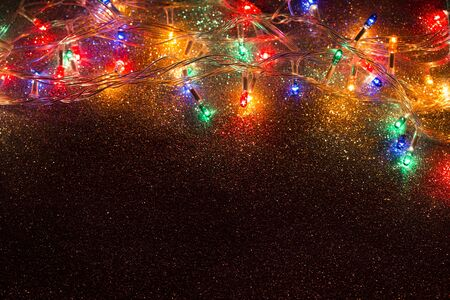 Christmas lights garland on a glistering  background
