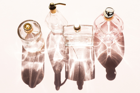 perfume oil: Perfume bottles on a bright light with the shadows