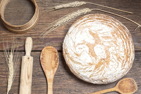 toned image: Home made bread with the wooden utensils - toned image Stock Photo