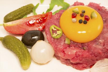 steak tartare: Steak Tartare with vegetables and egg yolk