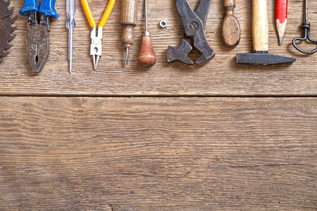 tools: Various tools on a wooden background