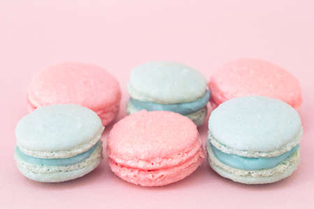red pink: Pink and blue macaroons  on a pink background