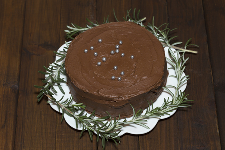 torte: Chocolate torte with rosemary on a white plate