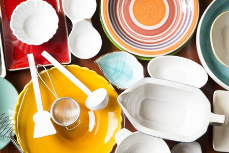 dining set: Colorful dishes and utensils as background Stock Photo