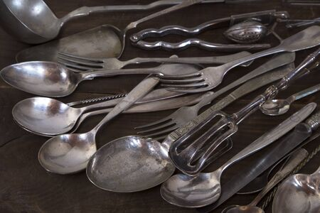 vintage cutlery: Pile of the vintage cutlery and utensils Stock Photo
