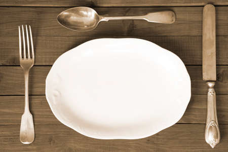 toned image: Vintage table setting - toned image Stock Photo