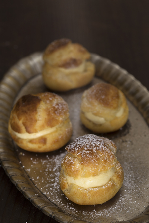 silver tray: Cream puffs on a silver tray Stock Photo