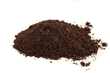 black soil: Soil heap on white background