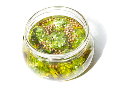 briny: cheese with parsley in a jar Stock Photo